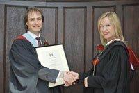 Sally-Ann Tarver presents Fellowship to Dr Rogers